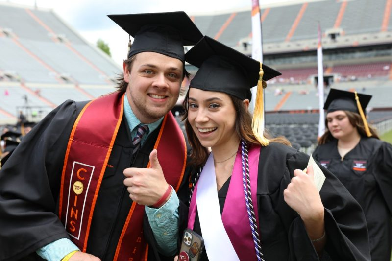 Mike Ellerbrock stands in front of a blackboard facing his students while teaching during his economics class.