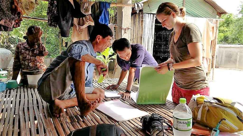 Sydni Jackson gathering survey responses from Cambodian farmers.