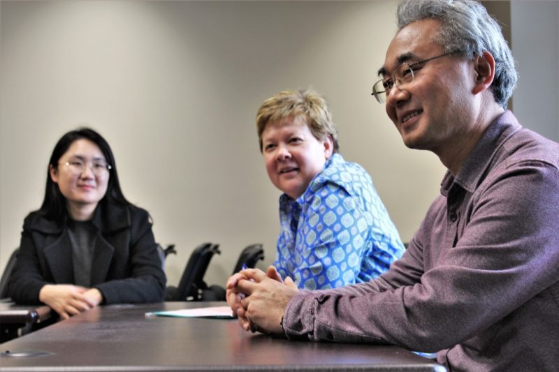 Nagoya University Professor Tadashi Sonoda meets with Associate Professor Susan Chen and graduate student Minkyong Ko.