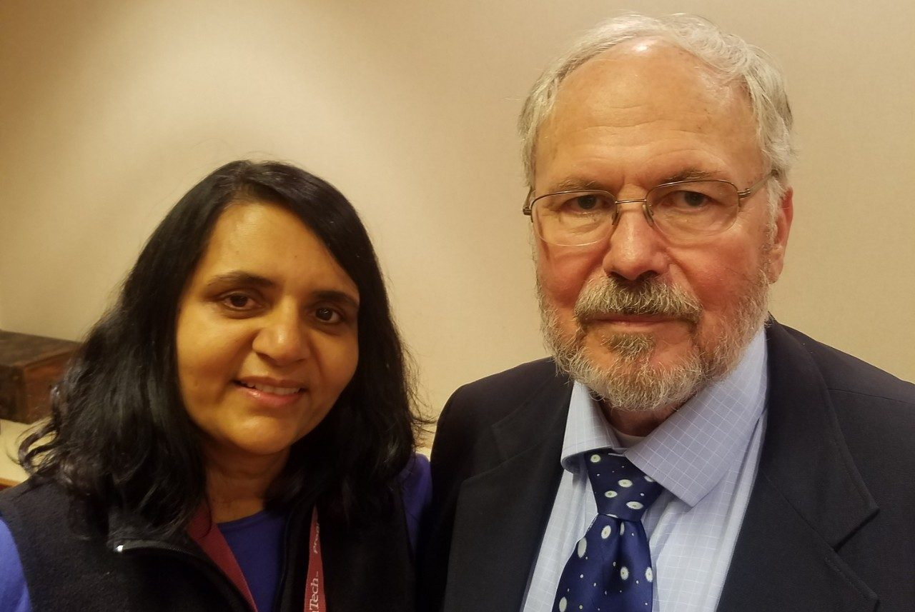 Leon Geyer at his retirement party with Achla Marathe.