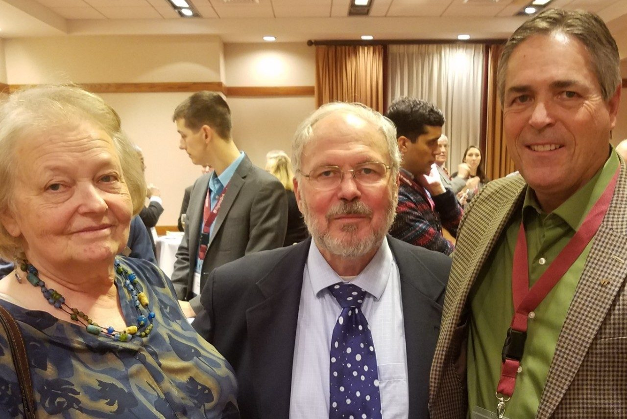 Leon Geyer at his retirement party with Janis Geyer and Dan Eversole.