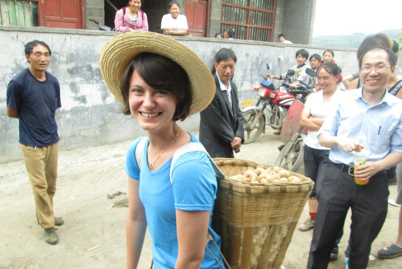 Stephanie Myrick carries potatoes on her back in a rural town in China.