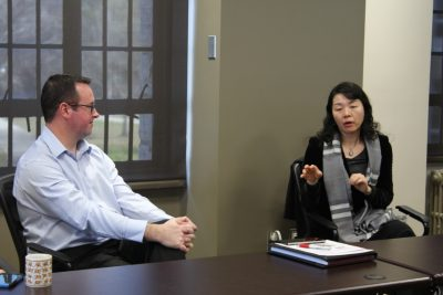 Dean Jing Zhu answers question from Virginia Tech Associate Professor and Director of the CALS Center for Agricultural Trade Jason Grant.