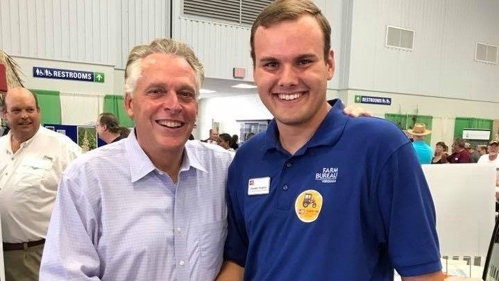Chandler Vaughan shakes hands with former Governor Terry McAuliffe at the 2017 State Fair of Virginia.